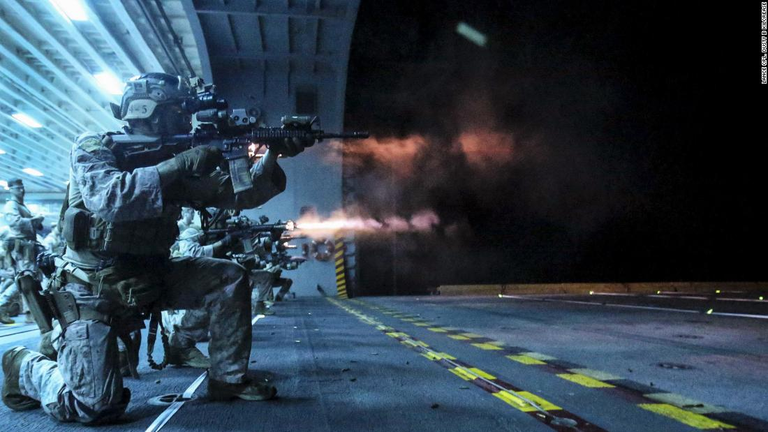 Marines conduct a low-light deck shoot to maintain marksmanship proficiency while underway aboard the amphibious assault ship USS America.