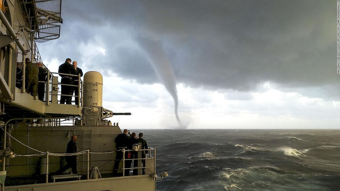 A waterspout forms as the USS Gerald R. Ford travels in the Atlantic Ocean on December 4.