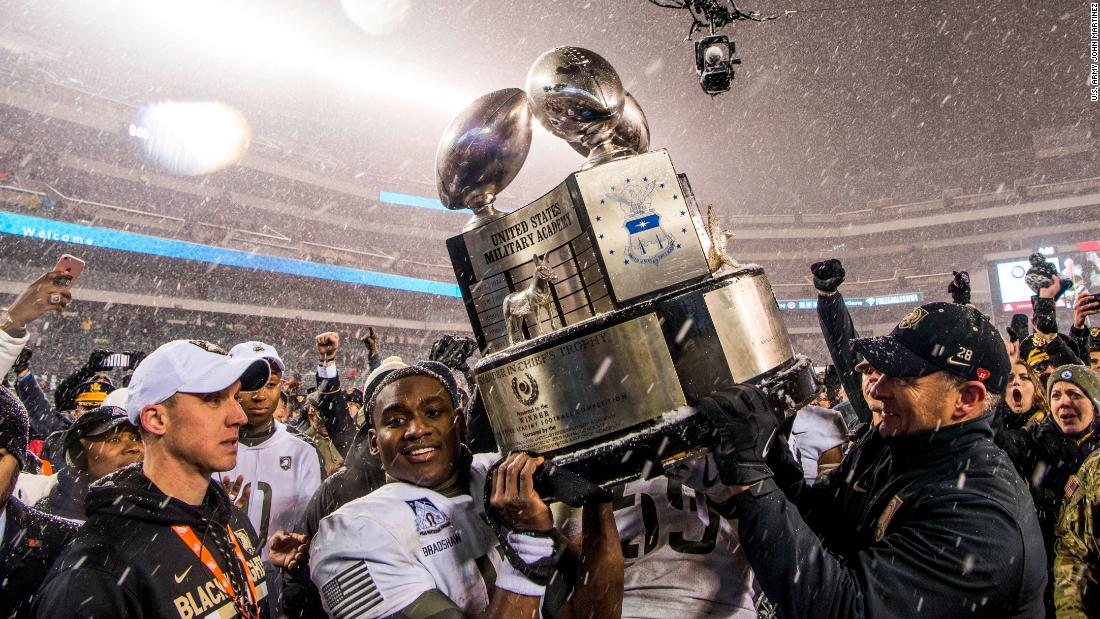 Army quarterback Ahmad Bradshaw and the Chief of Staff of the Army Gen. Mark Milley raise up the Commander in Chief's Trophy at the Army Navy Game in Philadelphia. Army beat Navy for the second straight year, 14-13, on December 9.
