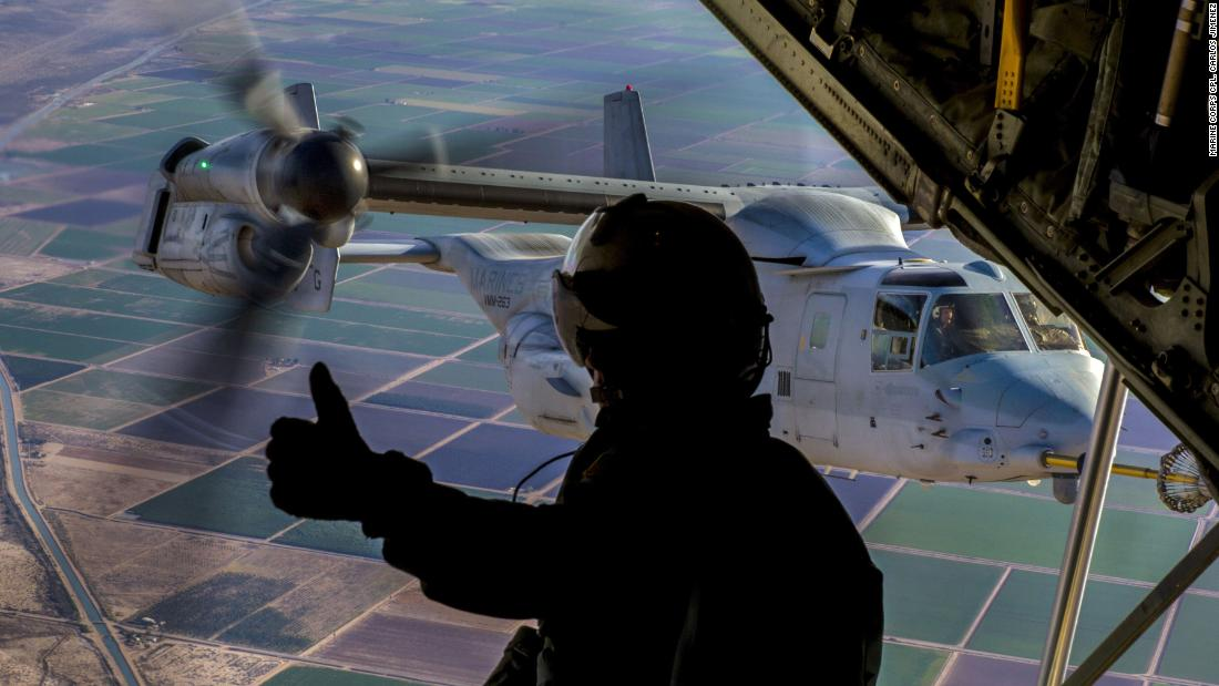 Marine Corps Cpl. Seth Witherup signals to a pilot during training at California's Naval Air Facility El Centro on December 6.