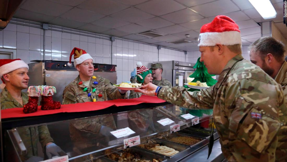 Members of the US military are served dinner on Christmas Day at the Resolute Support Headquarters in Kabul, Afghanistan on December 25.