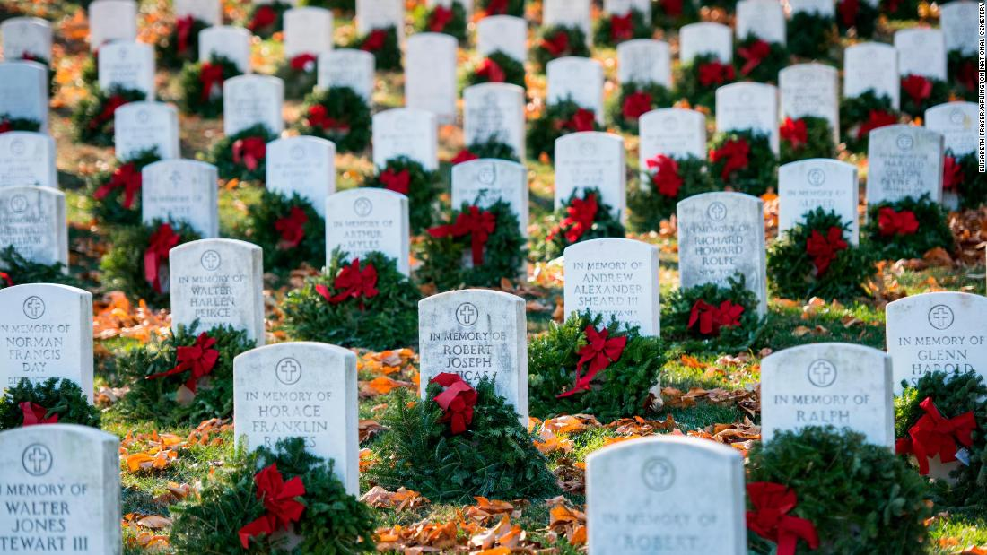 Wreaths lie on memorial markers during the Wreaths Across America event at Arlington National Cemetery on December 16.
