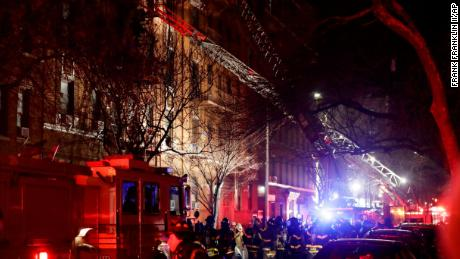 Firefighters respond to a building fire Thursday, December 28 in the Bronx borough of New York. The Fire Department of New York says a blaze raging in the Bronx apartment building has seriously injured more than a dozen of people.