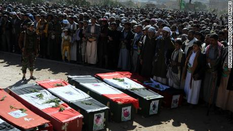 SANA'A, YEMEN -- DECEMBER 26: People carry coffins of 11-members from one family after they were killed by airstrikes carried out by the Saudi-led coalition hit their house on Monday leaving the nine members including five children killed on December 26, 2017 in Sana'a, Yemen. The Houthi-run Saba news agency reported that at least 71 civilians, including 11 children, were killed in Yemen in 51 airstrikes carried out by the Saudi Arabia-led military coalition across the country over a 48-hour period. (Photo by Mohammed Hamoud/Getty Images)