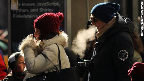 People walk through a frigid Manhattan on December 28, 2017 in New York City. Dangerously low temperatures and wind chills the central and eastern United States are making outdoor activity difficult for many Americans.  Little relief from the below normal temperatures is expected the first week of the New Year.