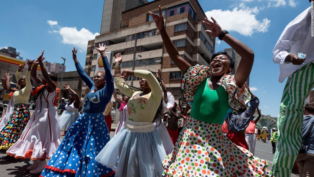 Performers parade through the streets as part of the annual Joburg Carnival in Johannesburg, South Africa. Many of the costumes are hand-made each year for the event.