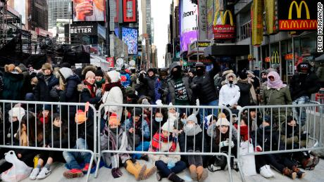 Spectators gather ahead of the New Year's Eve celebration in Times Square in New York, on Sunday, Dec. 31, 2017. New Yorkers, celebrity entertainers and tourists from around the world will pack into Times Square for what's expected to be a flashy but frigid celebration marking the start to the new year.