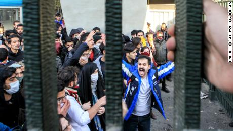 People gather to protest over high cost of living in Tehran.