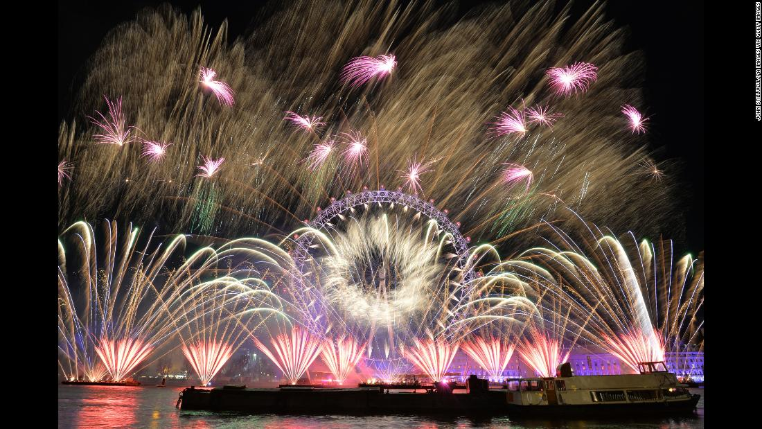 Fireworks light up the sky over the London Eye in central London.