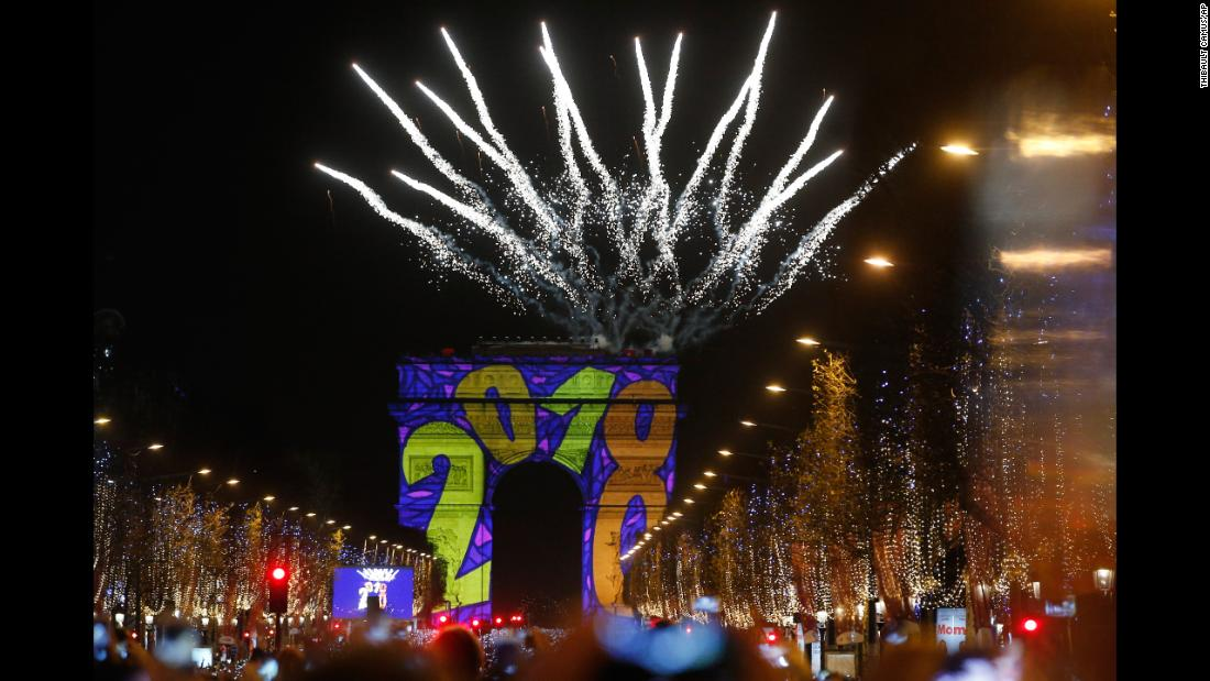 Lights and fireworks are seen at the Arc de Triomphe on the Champs-Élysées in Paris.