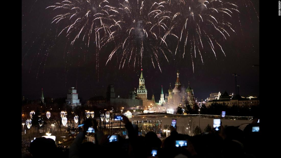 Fireworks explode over the Kremlin in Moscow.