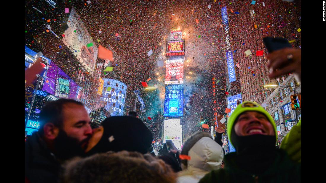 Confetti falls over the crowd as the clock strikes midnight at Times Square in New York.