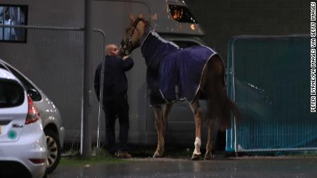 A horse is led away during the Liverpool International Horse Show held at the Echo Arena following a blaze at a multi-storey car park nearby.