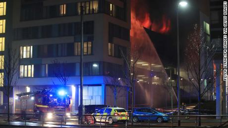 Emergency services at a blaze at a multi-storey car park at the Echo Arena on Liverpool's waterfront.