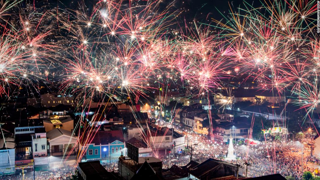 Fireworks illuminate the city's skyline during New Year's celebrations in Yogyakarta, Indonesia.