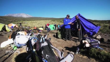 African Voices trekking kilimanjaro with africa's top mountain man B_00000000