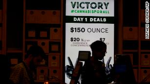 A sign advertises deals at Harborside marijuana dispensary on Monday.