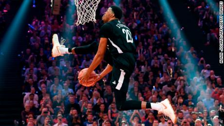 TOPSHOT - US DJ Stephens competes during the slam dunk contest of the All Star Game basketball game of the French National Basketball League (LNB) between a selection of the best international players from the Pro A league against a selection of the best French players on December 29, 2017 at the AccorHotels Arena in Paris.  / AFP PHOTO / ALAIN JOCARD        (Photo credit should read ALAIN JOCARD/AFP/Getty Images)