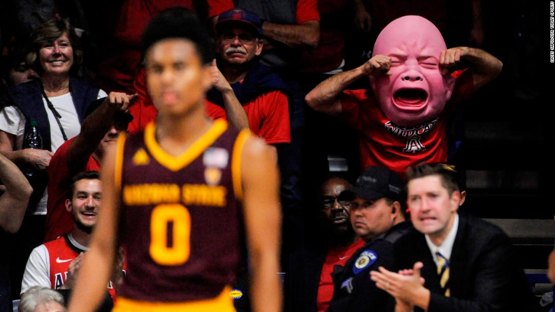 An Arizona basketball fan wears a baby mask during a college basketball game on Saturday, December 30.