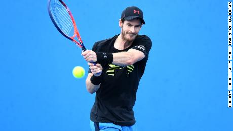 "Murray, speaking from his hospital bed, told reporters he was ""not finished playing tennis yet."""