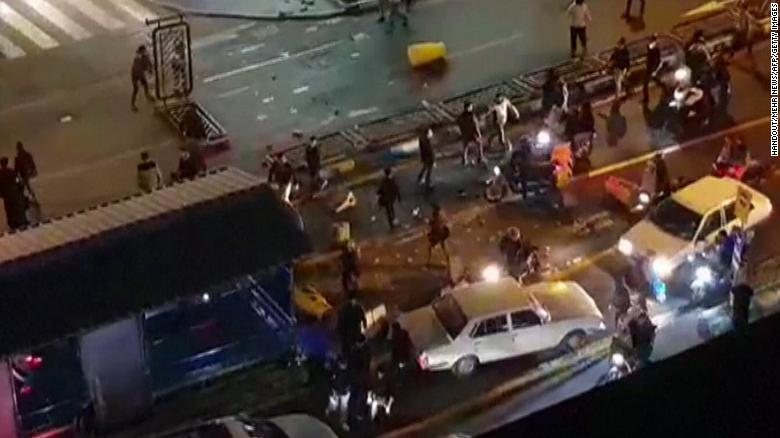"An image grab taken from a handout video released by Iran's Mehr News agency reportedly shows a group of men pushing traffic barriers in a street in Tehran on December 30, 2017. Ten people died overnight in fresh unrest in Iran, local media reported on January 1, 2018, despite President Hassan Rouhani calling for calm and vowing more ""space for criticism"" in a bid to head off days of protest. / AFP PHOTO / MEHR NEWS / Handout / RESTRICTED TO EDITORIAL USE - MANDATORY CREDIT ""AFP PHOTO / HO / MEHR NEWS"" - NO MARKETING NO ADVERTISING CAMPAIGNS - DISTRIBUTED AS A SERVICE TO CLIENTS  NO RESALE - NO BBC PERSIAN / NO VOA PERSIAN / NO MANOTO TVHANDOUT/AFP/Getty Images"