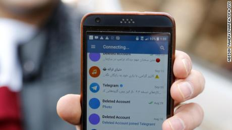 An Iranian man shows his phone as certain apps were restricted in Tehran on Tuesday.