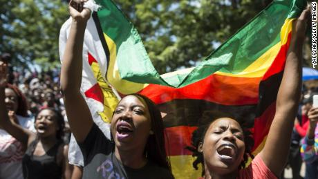 Demonstrators call for the resignation of Zimbabwe's former President Robert Mugabe. Will they see genuine democracy in 2018?