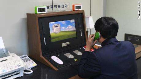 A South Korean official speaks with a North Korean officer on the hotline on Wednesday.