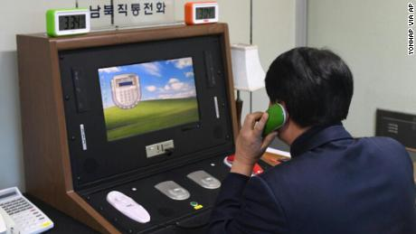 A South Korean government official communicates with a North Korean officer during a phone call on the dedicated communications hotline at the border village of Panmunjom in Paju, South Korea, Wednesday, Jan. 3, 2018. North Korean leader Kim Jong Un reopened a key cross-border communication channel with South Korea on Wednesday, another sign easing animosity between the rivals even as Kim traded combative threats of nuclear war with President Donald Trump. (Yonhap via AP)