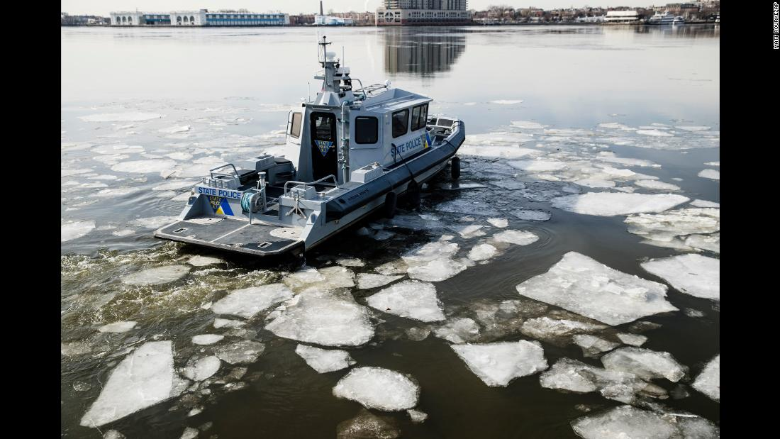 A New Jersey State Police boat maneuvers through ice on the Delaware River on January 3.