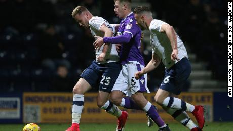 Kevin O'Connor (No. 25) playing for Preston against Bolton.