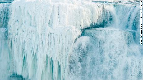 Ice hangs from the top of the American side of Niagara Falls on January 3, 2018.  The cold snap which has gripped much of Canada and the United States has nearly frozen over the American side of the falls. / AFP PHOTO / Geoff Robins        (Photo credit should read GEOFF ROBINS/AFP/Getty Images)