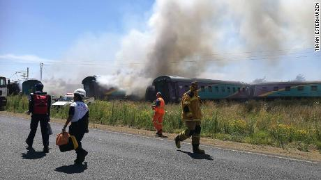 Rescue workers are seen at the site of a train crash Thursday between Hennenman and Kroonstad.