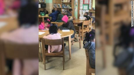 Baltimore elementary school teacher Aaron Maybin says he took this photo of children -- some wearing coats -- in his classroom at Matthew A. Henson Elementary School on Wednesday, January 3, 2018.