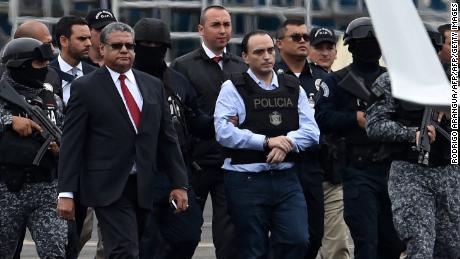 The former governor of the Mexican state of Quintana Roo, Roberto Borge (C) is escorted by the police during his extradition to Mexico, at Panama City's Tocumen international airport on January 4, 2018. Panama extradited former Mexican state governor Roberto Borge to Mexico to face charges of alleged graft, the Central American country's foreign ministry said. Borge, 38, had exhausted legal efforts in Panama to slow the extradition process as he was kept in custody. He was arrested June 4, 2017 in Panama when he tried to board a flight to Paris.  / AFP PHOTO / Rodrigo ARANGUARODRIGO ARANGUA/AFP/Getty Images