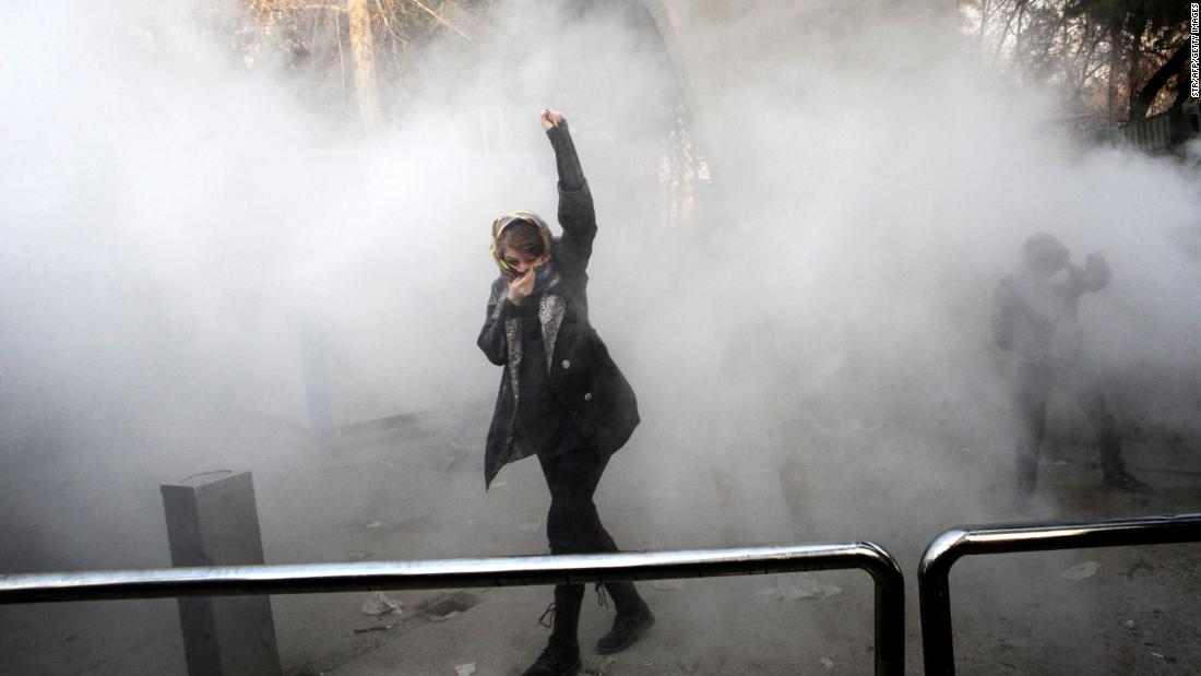 "A woman in Tehran, Iran, is surrounded by tear gas during <a href=""http://www.cnn.com/2017/12/30/middleeast/iran-protests-intl/index.html"" target=""_blank"">anti-government protests</a> at the University of Tehran on Saturday, December 30. The protests, which spread to a number of cities, emerged against a backdrop of rising food and gasoline prices."
