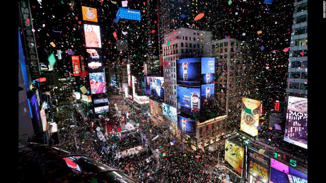 "Confetti drops over the crowd in New York's Times Square as the clock strikes midnight on Monday, January 1. <a href=""http://www.cnn.com/2017/12/31/world/gallery/2018-new-year/index.html"" target=""_blank"">See New Year's celebrations from around the world</a>"