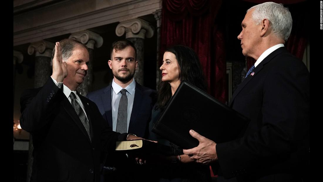 "US Sen. Doug Jones is joined by his wife, Louise, and his son Carson as Vice President Mike Pence conducts a mock swearing-in ceremony on Wednesday, January 3. Jones is the first Democrat that Alabama has elected to the Senate since 1992. <a href=""http://www.cnn.com/2017/12/13/politics/doug-jones/index.html"" target=""_blank"">He defeated Republican Roy Moore last month</a> in a special election."