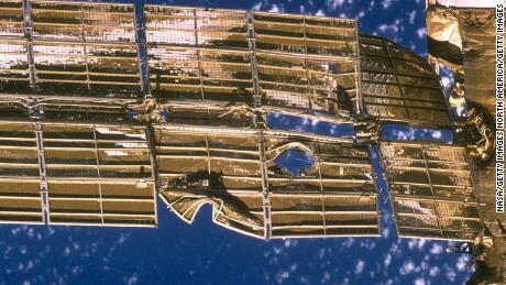 A close-up view of the solar array panel on Russia's Mir space station shows damage incurred by the impact in 1997 of a Russian unmanned resupply ship.