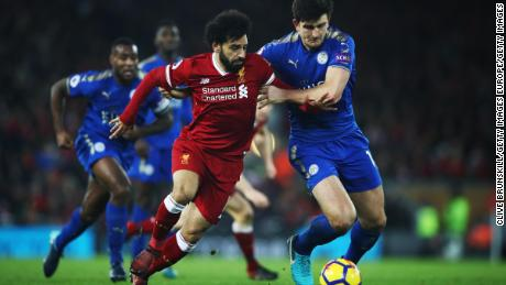 LIVERPOOL, ENGLAND - DECEMBER 30:  Mohamed Salah of Liverpool breaks past Harry Maguire of Leicester City to score his team's second goal during the Premier League match between Liverpool and Leicester City at Anfield on December 30, 2017 in Liverpool, England.  (Photo by Clive Brunskill/Getty Images)