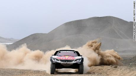 Peugeot's French driver Sebastien Loeb and co-driver Daniel Elena of France take part in a driving session, on the eve of technical checkup in San Bartolo 75 km south of Lima, on January 4, 2018, ahead of the 2018 Dakar Rally, which this year will thunder through Peru, Bolivia and Argentina from January 6 to 20. / AFP PHOTO / FRANCK FIFE        (Photo credit should read FRANCK FIFE/AFP/Getty Images)