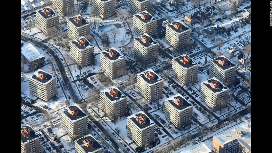 Apartment buildings in New York City poke out from the snow on January 5.