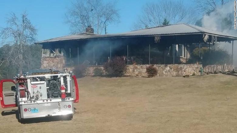 Tina Johnson's house caught fire Wednesday, authorities said.