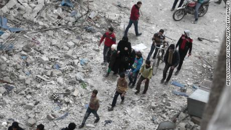 Syrian civilians inspect the damage following air raids on Eastern Ghouta, Syria, on Saturday.