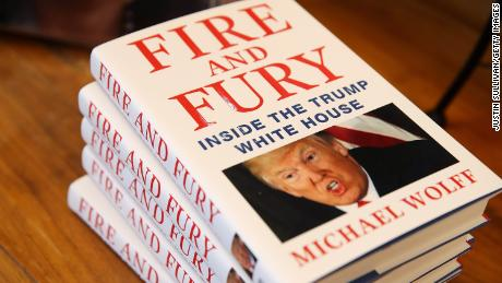 "Copies of the book ""Fire and Fury"" by author Michael Wolff are displayed on a shelf at Book Passage on January 5, 2018 in Corte Madera, California. A controversial new book about the inner workings of the Trump administration hit bookstore shelves nearly a week earlier than anticipated after lawyers for Donald Trump issued a cease and desist letter to publisher Henry Holt & Co."