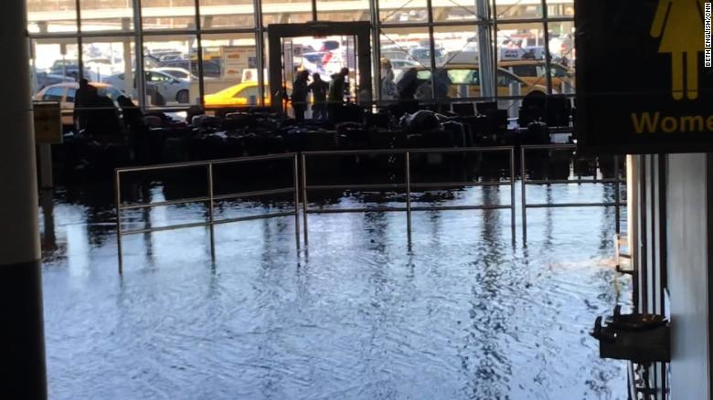 Flooding at JFK Airport in a baggage claim area.