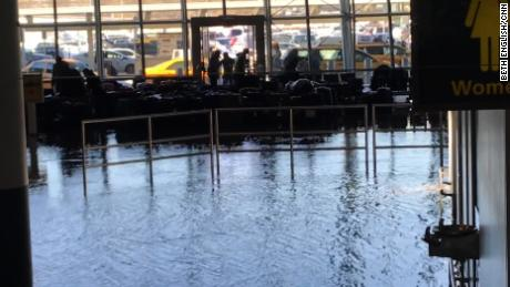 Flooding at JFK airport in the baggage claim.