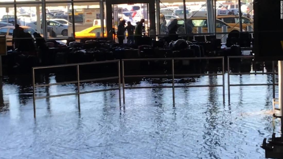 Water leak floods crowded JFK Airport baggage claim