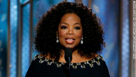 Presenter Oprah Winfrey speaks onstage during the 72nd Annual Golden Globe Awards at The Beverly Hilton Hotel