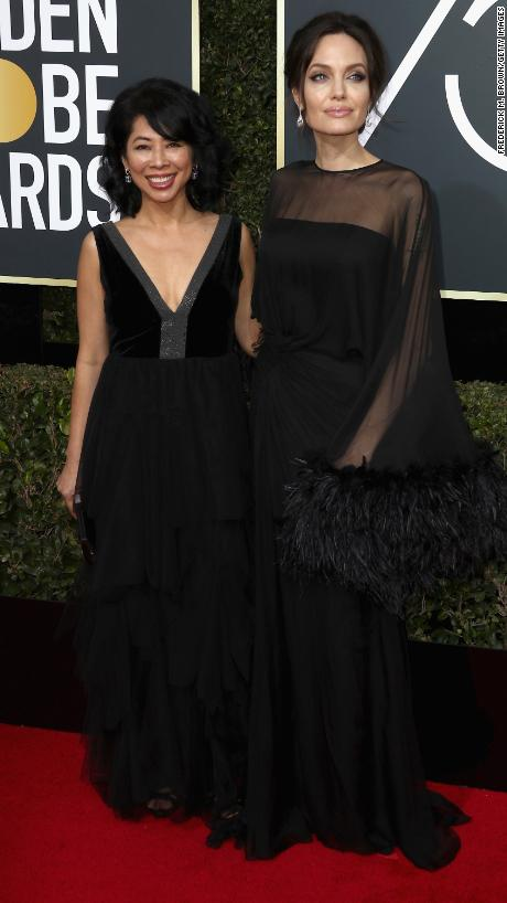 "Loung Ung, left, and Angelina Jolie. Ung, a spokeswoman for the Campaign for a Landmine-Free World, was one of <a href=""http://www.cnn.com/2018/01/07/entertainment/golden-globes-activists-actresses-red-carpet/index.html"" target=""_blank"">several activists</a> who appeared on the red carpet with actors."